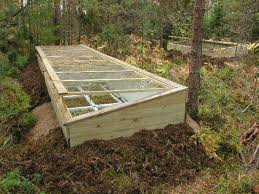 the glass windows can be lifted off from the wooden supports the size of the cold frame is optimized for large plant boxes that can stay
