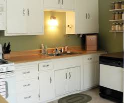 white cabinets sage green walls