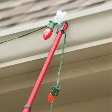 Holiday Light Hanging Pole The Ladder Free Christmas Light Hanger Hammacher Schlemmer