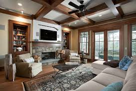 shelving beside fireplace living room rustic with coffered ceiling floating display and wall shelves