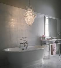 bathroom with freestanding tub and crystal chandelier cleaning tips for crystal chandelier