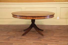 62 inch round formal and tradtional satinwood pedestal table with inlaid place mats