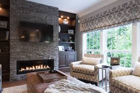 stacked stone fireplace ideas family room traditional with brown ottoman built in bookcase