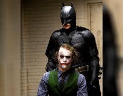 bale as batman and heath ledger as the joker in the dark knight