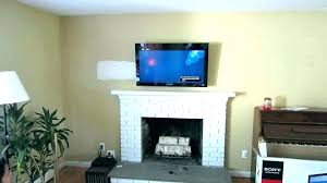 awesome mount above fireplace and mounting hiding wires hide in brick wall nook tv luxury fireplac