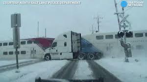 Train slams into truck, barely missing 2 men inside - YouTube