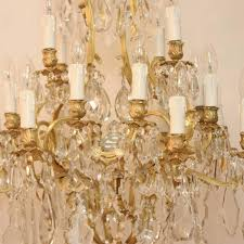 louis xv large 19th century french gilt bronze and cut crystal 20 light chandelier