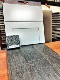 Cabinets: Sonoma Painted Maple Linen Granite: New Caledonia (level 1)  Hardwood Flooring: Misty Gray (level B)