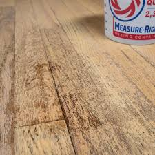 water spot soaking into hardwood flooring in need of refinishing