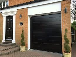 hormann garage doorHormann black sectional garage door  Pennine Garage Doors