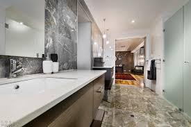 Marble Flooring Bathroom A Big Door Way From The Bedroom Towards The Bathroom With Marble