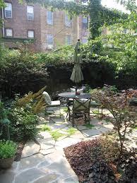 stone patio installation: irregular stone paving design garden santuary  irregular stone paving design