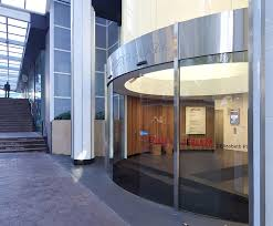 no 2 elizabeth plaza in north sydney was upgraded in 2016 the generic straight sliding door entrance was replaced with a striking curved frameless glass