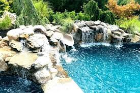 In ground pools with waterfalls Corner Waterfall Swimming Pool Waterfall Kits Uk With Pools By Design New Jersey Deck Wit Inground Pool Waterfalls Swimmingpoolcom Inground Pool Waterfall Plumbing Above Ground Waterfalls Ideas