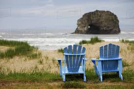 adirondack chairs on beach. Brilliant Chairs Two Blue Adirondack Chairs On A Grassy Beach With Rock Formations In The  Ocean Rockaway Beach Oregon United States Of America A