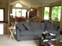 oak trim throughout dark grey sofa