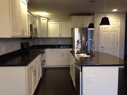 white shaker cabinets with quartz countertops. white kitchen cabinets with black quartz countertops shaker