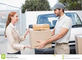 Delivery Driver Passing Parcels To Happy Customer Stock