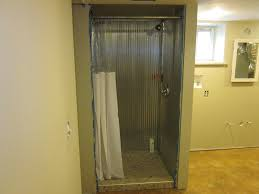 the simpsons major work done corrugated metal walls above you see the finished shower with corrugated steel walls and tiled floor its cool and is testimony