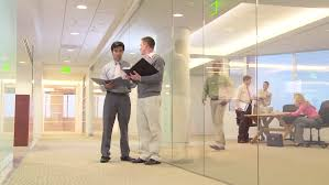 hallway office. busy office workers meeting in hallway hd stock video clip