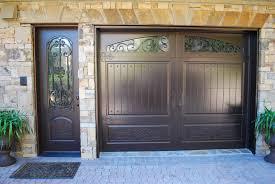 matching single garage door side door finished in weathered bronze garage doors entry doors 678 894 1450 masterpiecedoors