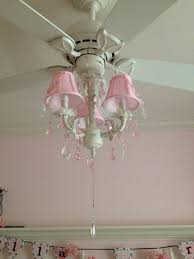 white chandelier with white tray lamps combined with pink lid also pink white hanging crystal ornaments