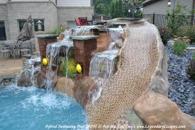 this custom hand carved waterfall and rock slide features beautiful lighting and a personalized