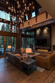 Rooms To Go Living Room Set With Tv 866 X 1200 Living Room With Two Story Tall Windows And A Cozy Low
