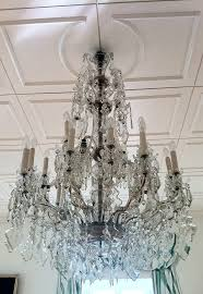 replacement parts with intricate cutting work and drilling for a large crystal glass chandelier