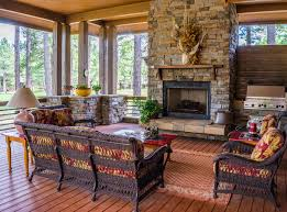 indoor stone fireplaces add high design to any porch or living space in your home take a look at the added stone work to this porch space by adding in