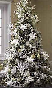 A white Porcelain Garden decorated tree from Raz Imports. (Note, not all  these products are available as the ranges change every year. Use these as  ideas, ...