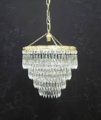 italian art deco four tier crystal glass chandelier