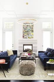 ann lowengart interiors modern living room in norcal blue velvet sofas and quartz lined chandelier
