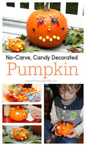 fun way to decorate pumpkins with small kids using candy a great carving alternative toddlers