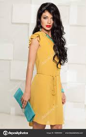 young brunette fashion model in yellow dress makeup stock photo