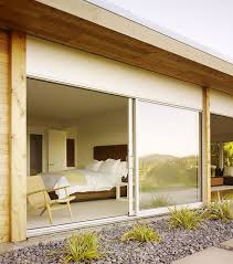 furniture frosted glass sliding doors separate the contemporary bedroom from the sleek bathroom equipped with blurring sliding door design