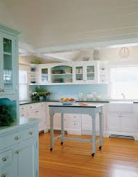 seaglass blue white and blue kitchen with green counters hutker architects via atticmag