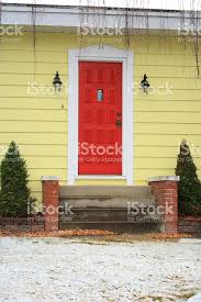 yellow brick house red door. red door on yellow house royalty-free stock photo brick p