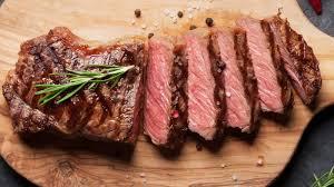 cutting steak right slicing against