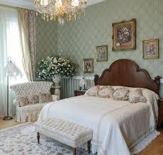 sage green wallpaper for elegant bedroom decorating ideas with ont crystal chandelier