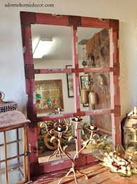 red distressed wall mirror with rustic metal accents is a truely must have for home decor very unique the mirror is simple and looks shabby rustic chic
