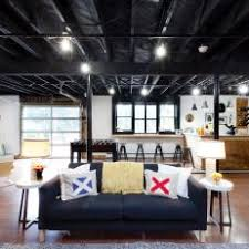 Exposed ceiling lighting basement industrial black Kitchen Spacious Basement With Industrial Ceiling Photos Hgtv Photos Hgtv