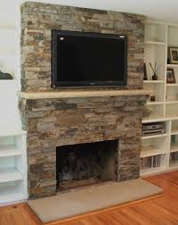 tv above a stone mantle and shelving on the sides i ve considered
