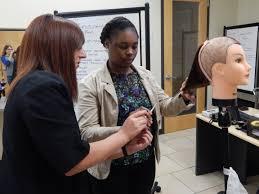 mentoring week a mentor helps a mentee learn a haircutting technique