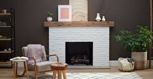refresh a brick fireplace with a crisp white coat of paint our friends at sherwin williams used loxon concrete and masonry primer followed by proclassic
