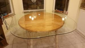 54 square glass table top with rounded corners measurement from rounded corner to rounded corner is 62 it is too big for our kitchen dinette area