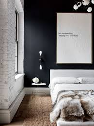 Example of an urban bedroom design in New York with black walls