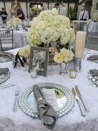 very elegant tablescape with minimal color mirror charger plates and a textured table cloth