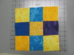 Learning Quilting at the National Quilt Museum in Kentucky & The quilt block made by author Mike Gerrard at a quilt-making workshop at  the Adamdwight.com