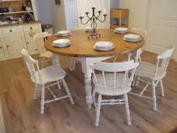vintage large round farmhouse table and 6 oak chairs